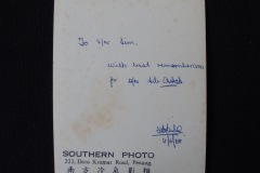 MALAY WEDDING PHOTOGRAPH 1 (Reverse)<p> Found in a Penang flea market, this Malay wedding photograph features a bride in a white wedding dress and is inscribed on the back with the date, 1968.</p>
