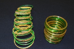 BEAUTIFICATION AND DECORATION - INDIAN BANGLES<p>Weddings in Penang, as elsewhere, involve substantial  investment in the dress and decoration of the bride and  groom. These items come from small local Indian wedding  shops.</p>