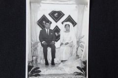 MALAY WEDDING PHOTOGRAPH 1<p> Found in a Penang flea market, this Malay wedding photograph features a bride in a white wedding dress and is inscribed on the back with the date, 1968.</p>