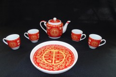CHINESE TEA SET<p> A central ritual in Chinese weddings is the tea ceremony  when the young couple serve tea to their elders, first at  the groom's parents' house and then at the bride's.</p>